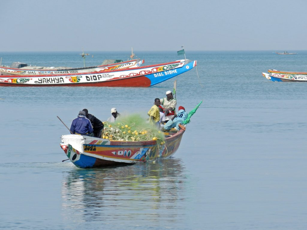 Fishermen in a canoe going to sea