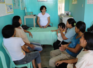 A rural health midwife explains family planning and the PHE link in  Ubay, Bohol, Philippines. (Credit: PFPI)