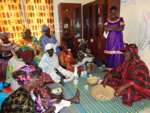 Women processors in Senegal incorporate local beliefs into their communications workshops. (credit: CRC/USAID/COMFISH)