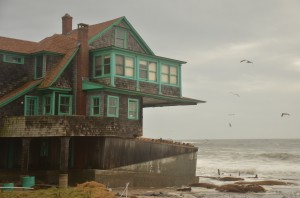 A home poised on the edge in coastal Rhode Island after Superstorm Sandy in 2012. (RI Sea Grant photo)